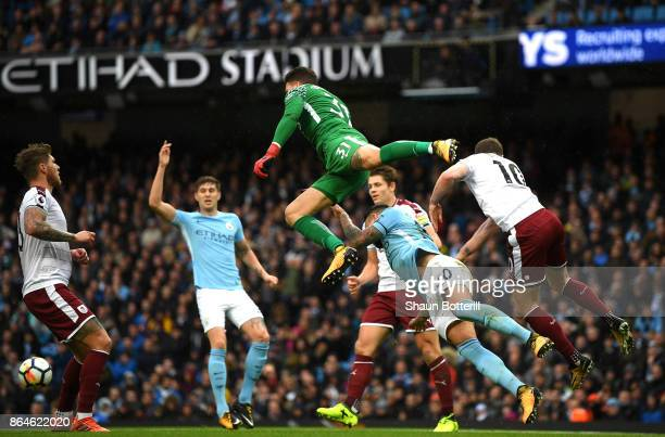 Ederson of Manchester City collides with Nicolas Otamendi of Manchester City and Ashley Barnes of Burnley during the Premier League match between...