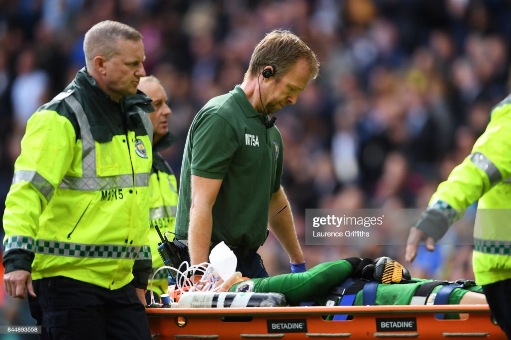 Ederson of Manchester City is stretchered off during the Premier League match between Manchester City and Liverpool at Etihad Stadium on September 9, 2017 in Manchester, England.