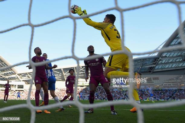 Ederson of Manchester City makes a save during the Premier League match between Brighton and Hove Albion and Manchester City at the Amex Stadium on...