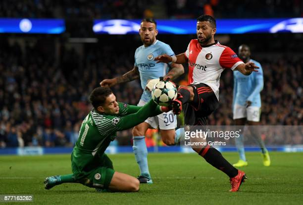 Ederson of Manchester City makes a save from Tonny Vilhena of Feyenoord during the UEFA Champions League group F match between Manchester City and...