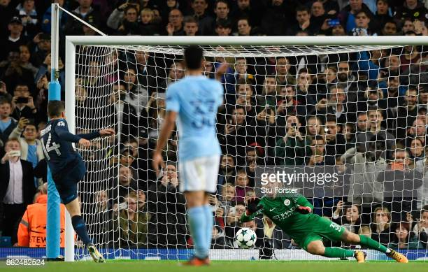 Ederson of Manchester City saves a penalty from Dries Mertens of SSC Napoli during the UEFA Champions League group F match between Manchester City...