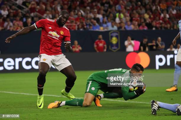 Ederson of Manchester City saves from Romelu Lukaku of Manchester United during the International Champions Cup 2017 match between Manchester United...