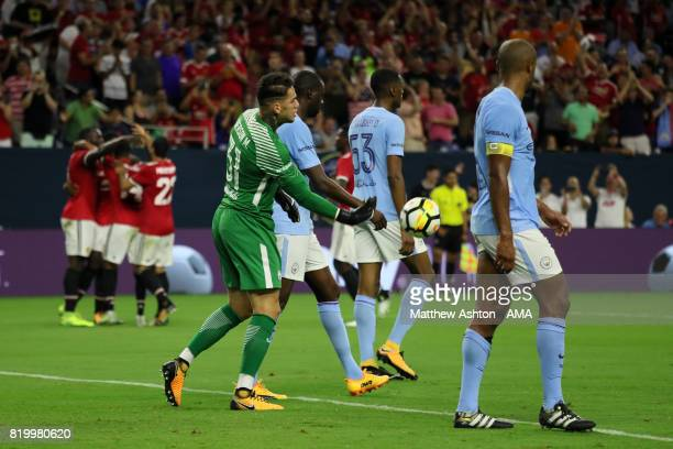 Ederson of Manchester City throws the ball back after Marcus Rashford of Manchester United scored a goal to make it 20 during the International...