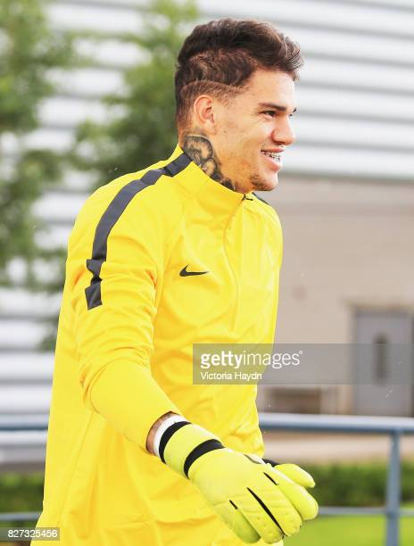 Ederson of Manchester City walks out prior to a training session at Etihad Campus on August 7 2017 in Manchester England