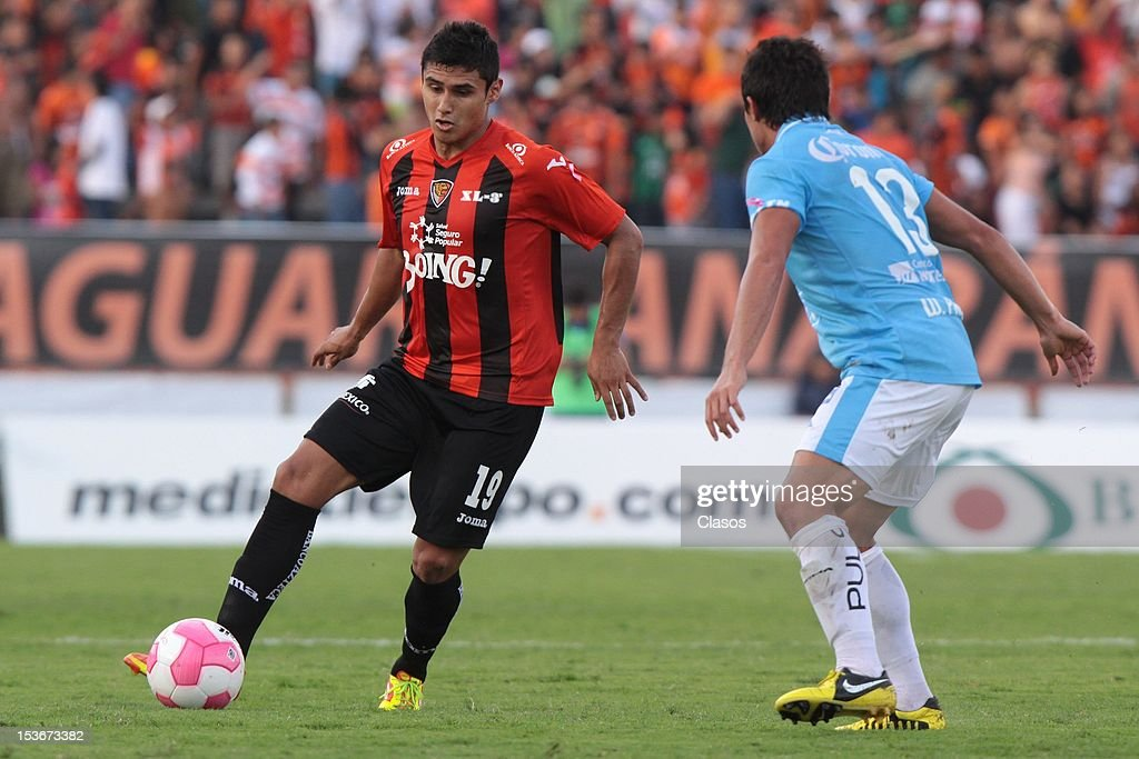 Edgar Andrade of Jaguares and William Paredes of San Luis fight for the ball during a match between Jaguares and San Luis as part of Liga MX 2012 at...
