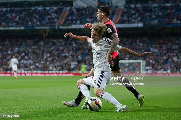 Edgar Antonio Mendez Ortega of Almeria UD tackles Fabio Coentrao of Real Madrid CF during the La Liga match between Real Madrid CF and UD Almeria at...