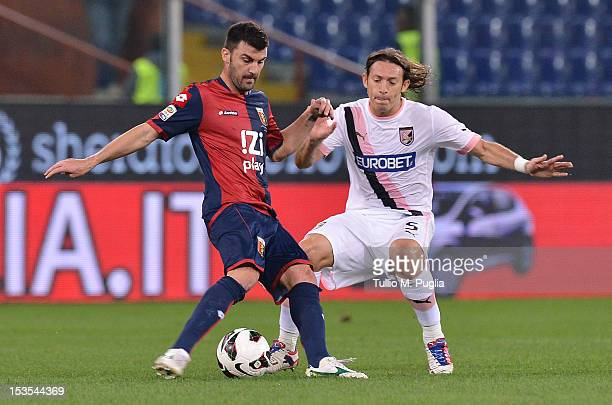 Edgar Barreto of Palermo and Cesare Bovo of Genoa compete for the ball during the Serie A match between Genoa CFC and US Citta di Palermo at Stadio...