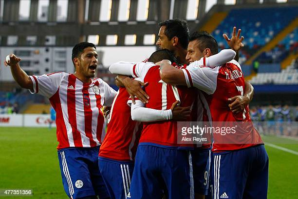 Edgar Benitez of Paraguay celebrates with teammaets after scoring the opening goal during the 2015 Copa America Chile Group B match between Paraguay...