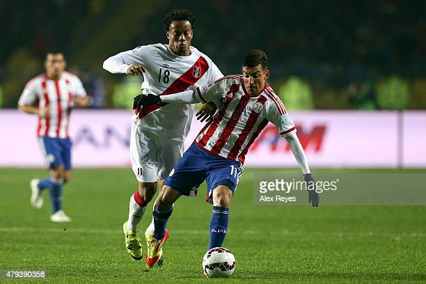 Edgar Benitez of Paraguay fights for the ball with Andre Carrillo of Peru during the 2015 Copa America Chile Third Place Playoff match between Peru...