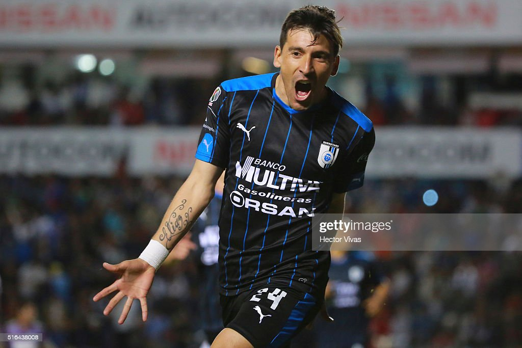 <a gi-track='captionPersonalityLinkClicked' href=/galleries/search?phrase=Edgar+Benitez&family=editorial&specificpeople=3433635 ng-click='$event.stopPropagation()'>Edgar Benitez</a> of Queretaro celebrates after scoring the first goal of his team during the 11th round match between Queretaro and Chiapas as part of the Clausura 2016 Liga MX at La Corregidora Stadium on March 18, 2016 in Queretaro, Mexico.