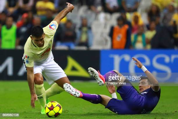 Edgar Benitez of Queretaro struggles for the ball with Silvio Romero of America during the 14th round match between America and Queretaro as part of...