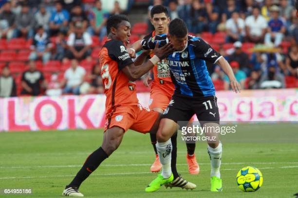 Edgar Benitez of Queretaro vies for the ball with Oscar Murillo of Pachuca during their Mexican Clausura 2017 Tournament football match at La...