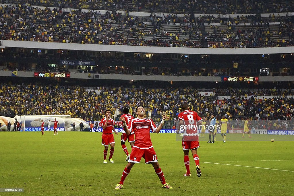 <a gi-track='captionPersonalityLinkClicked' href=/galleries/search?phrase=Edgar+Benitez&family=editorial&specificpeople=3433635 ng-click='$event.stopPropagation()'>Edgar Benitez</a> of Toluca celebrates a scored goal during a match against America as part of the semifinal Apertura 2012 Liga MX at Azteca Stadium on November 22, 2012 in Mexico City, Mexico