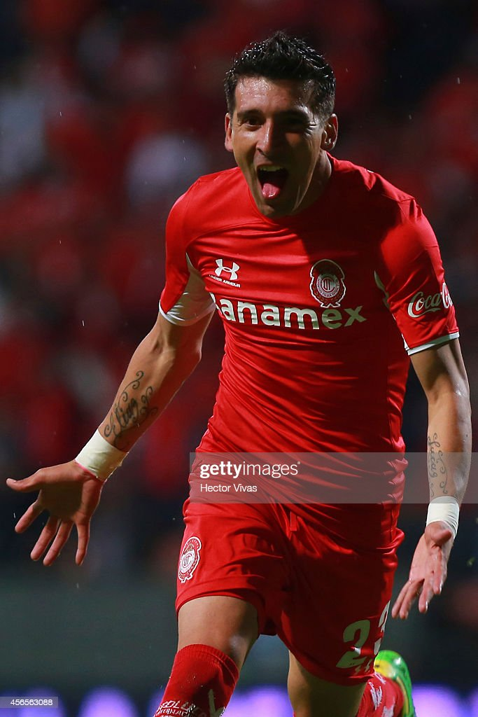 <a gi-track='captionPersonalityLinkClicked' href=/galleries/search?phrase=Edgar+Benitez&family=editorial&specificpeople=3433635 ng-click='$event.stopPropagation()'>Edgar Benitez</a> of Toluca celebrates after scoring the second goal of his team during a match between Toluca and Chivas as part of 11th round Apertura 2014 Liga MX at Nemesio Diez Stadium on October 02, 2014 in Toluca, Mexico.