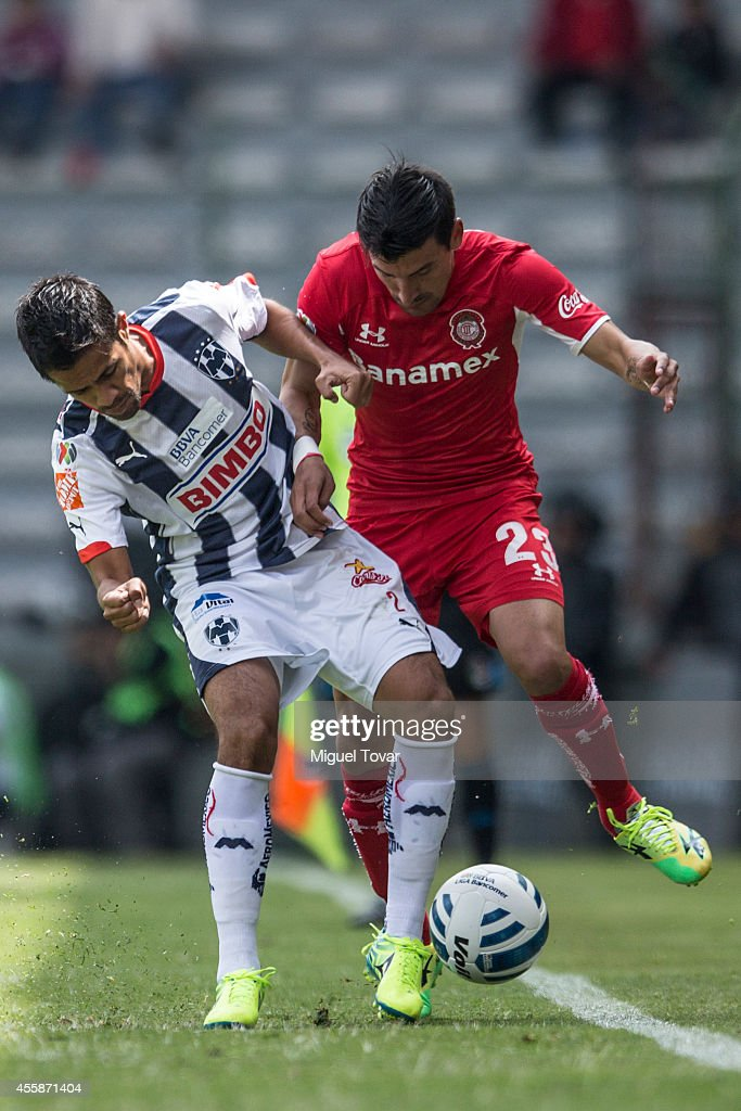 Edgar Benitez of Toluca fights for the ball with Severo Meza of Monterrey during a match between Toluca and Monterrey as part of 9th round Apertura...