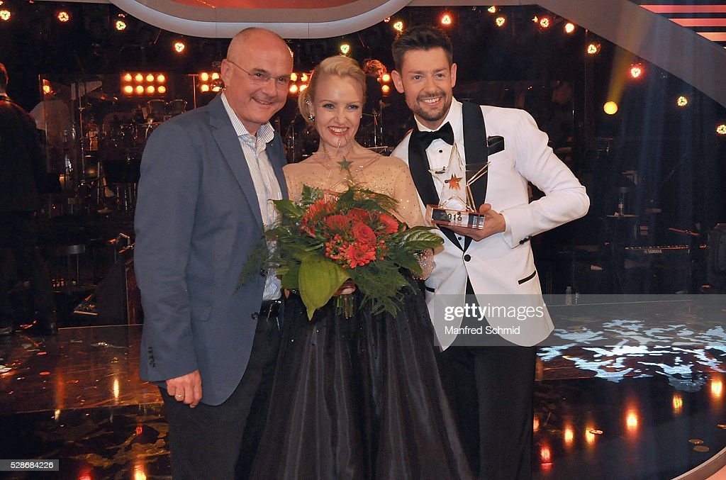 Edgar Boehm, Verena Scheitz and Florian Gschaider (L-R) pose during the 'Dancing Stars' finals in Vienna at ORF Zentrum on May 6, 2016 in Vienna, Austria.