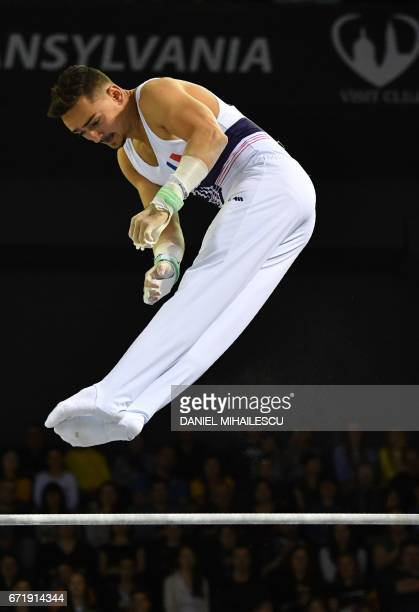 Edgar Boulet of France performs on the men horizontal bar apparatus final for the European Artistic Gymnastics Championship in Cluj Napoca Romania...