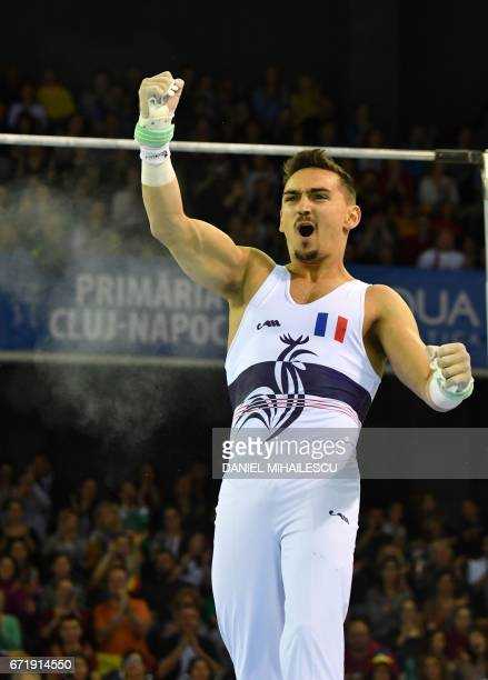 Edgar Boulet of France reacts after performing on the men horizontal bar apparatus final for the European Artistic Gymnastics Championship in Cluj...