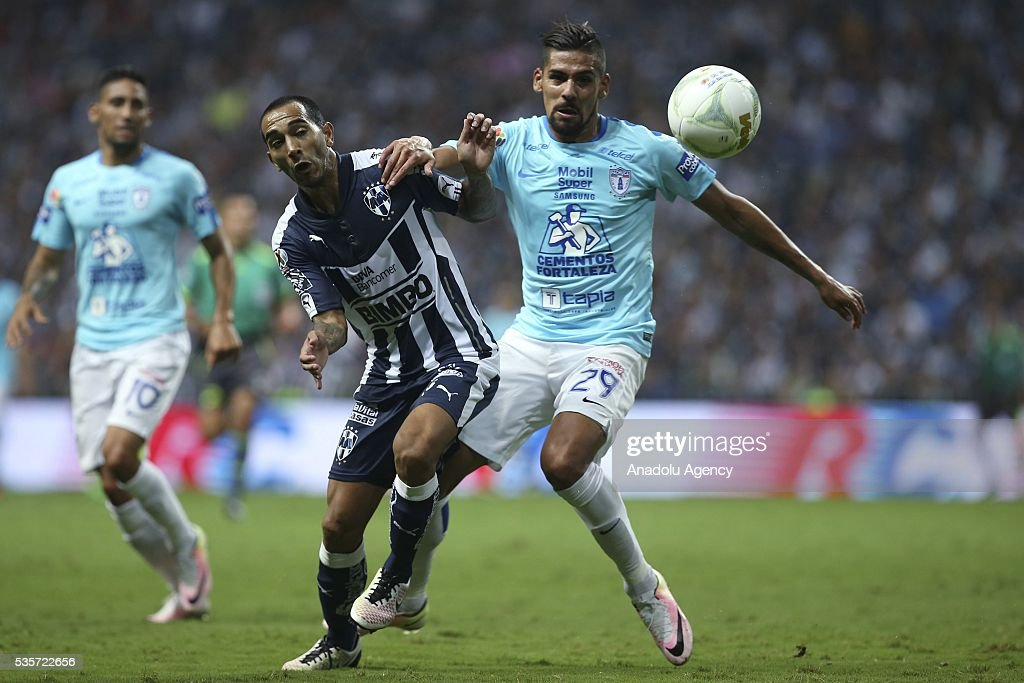 Edgar Castillo (L) of Monterrey in action against Franco Jara (R) of Pachuca during the Final second leg match of the Clausura 2016 Liga MX between Monterrey and Pachuca, at BBVA Bancomer Stadium, in Monterrey, Mexico on May 29, 2016.