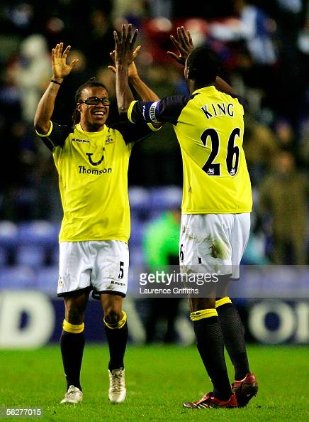 Edgar Davids and Ledley King of Spurs celebrate an away win during the Barclays Premiership match between Wigan Athletic and Tottenham Hotspur on...