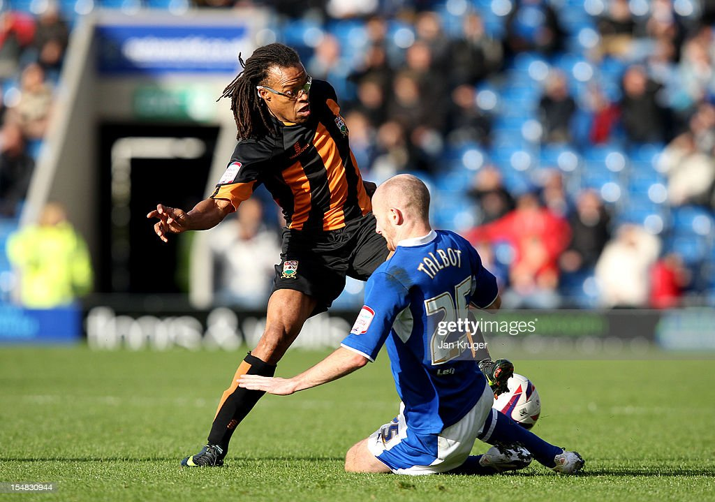 Edgar Davids (L) of Barnet is tackled by Drew Talbot of Chesterfield during the npower League Two match between Chesterfield and Barnet at Proact Stadium on October 27, 2012 in Chesterfield, England.