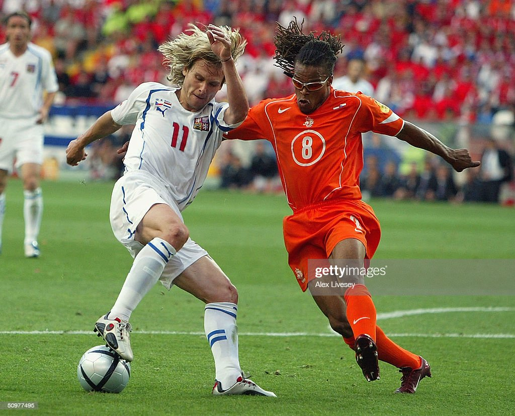 <a gi-track='captionPersonalityLinkClicked' href=/galleries/search?phrase=Edgar+Davids&family=editorial&specificpeople=213130 ng-click='$event.stopPropagation()'>Edgar Davids</a> of Holland clashes with Pavel Nedved of the Czech Rep scores the first goal during the UEFA Euro 2004, Group D match between Holland and the Czech Rep at the Municiple de Aveiro Stadium on June 19, 2004 in Aveiro, Portugal.