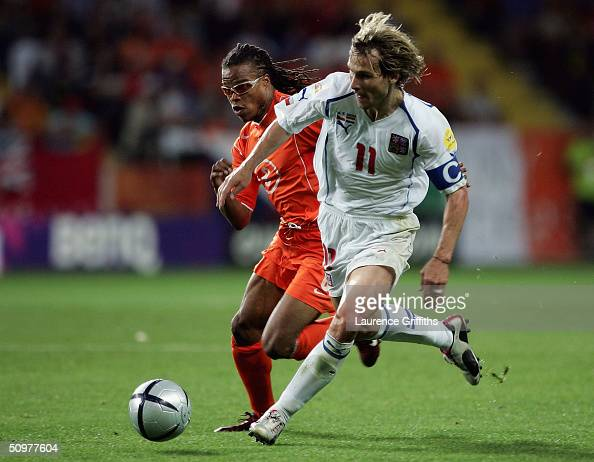 Edgar Davids of Holland clashes with Pavel Nedved of the Czech Rep during the UEFA Euro 2004 Group D match between Holland and the Czech Rep at the...