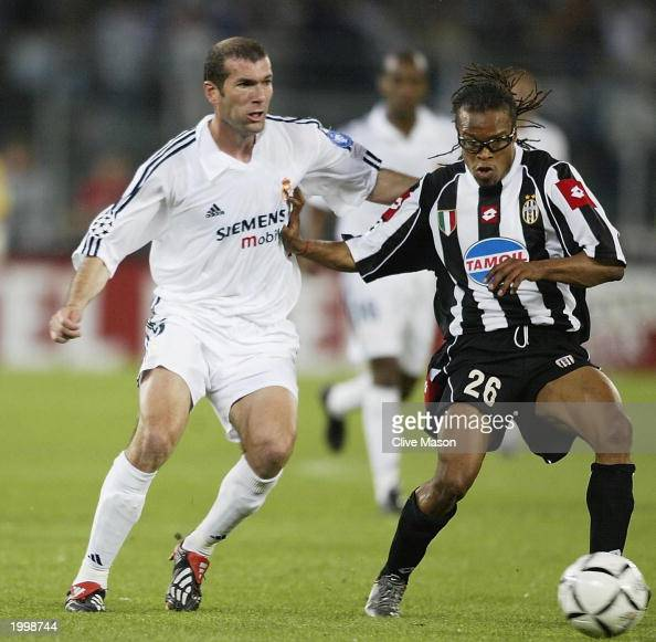 Edgar Davids of Juventus holds off a challenge from Zinedine Zidane of Real Madrid during the UEFA Champions League semi final second leg match...
