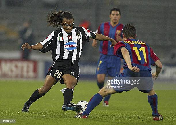 Edgar Davids of Juventus looks to take the ball past Marc Overmars of Barcelona during the UEFA Champions League quarterfinals first leg match held...