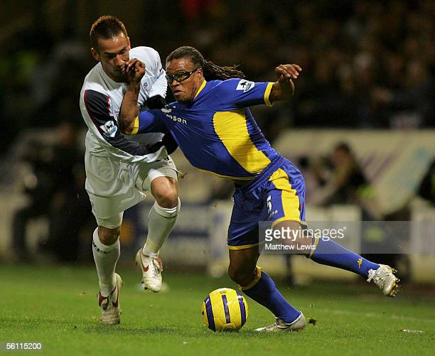 Edgar Davids of Tottenham holds off Hidetoshi Nakata of Bolton during the Barclays Premiership match between Bolton Wanderers and Tottenham Hotspur...