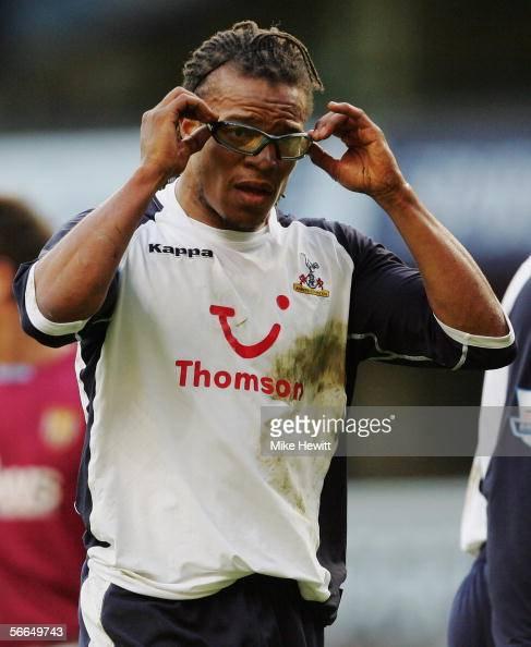 Edgar Davids of Tottenham Hotspur adjusts his glasses during the Barclays Premiership match between Tottenham Hotspur and Aston Villa at White Hart...