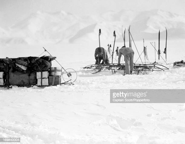 Edgar Evans and Titus Oates repairing a sledge on the Beardmore Glacier photographed during the last tragic voyage to Antarctica by Captain Robert...
