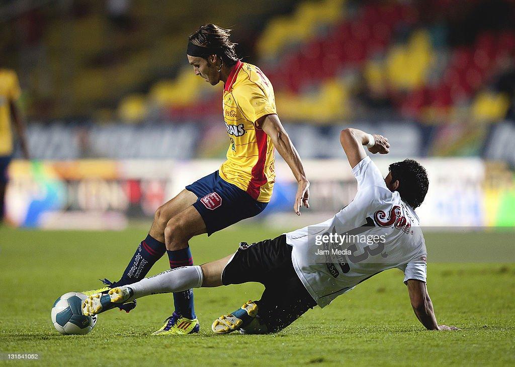 Edgar Gerardo Lugo of Morelia struggles for the ball with Jorge Rodriguez of Jaguares during their match as part of the Apertura 2011 at the Morelos...