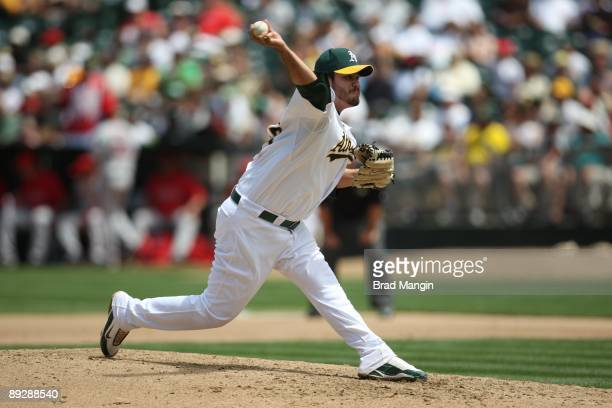 Edgar Gonzalez of the Oakland Athletics pitches against the Los Angeles Angels of Anaheim during the game at the OaklandAlameda County Coliseum on...