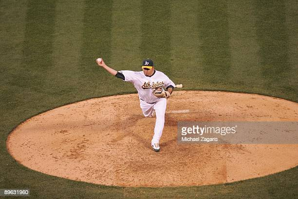 Edgar Gonzalez of the Oakland Athletics pitches during the game against the San Francisco Giants at the Oakland Coliseum on June 24 2009 in Oakland...