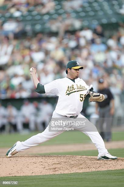 Edgar Gonzalez of the Oakland Athletics pitches during the game against the Colorado Rockies at the Oakland Coliseum on June 27 2009 in Oakland...