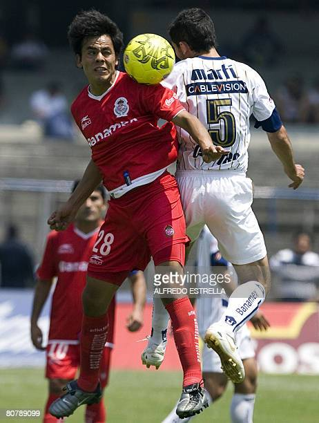 Edgar Gonzalez of Toluca vies for the ball with Israel Castro of Pumas during their Mexican league football match in Mexico City on April 20 2008 AFP...