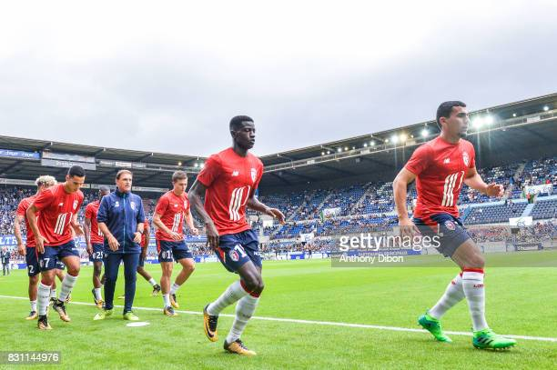 Edgar Ie and Junior Alonso of Lille during the Ligue 1 match between Racing Club Strasbourg and Lille OSC at Stade de la Meinau on August 13 2017 in...
