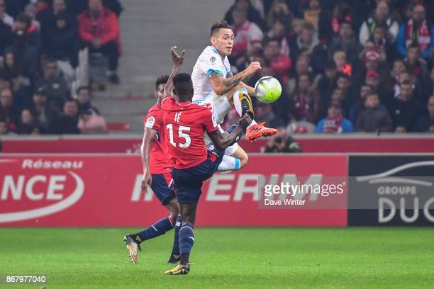 Edgar Ie of Lille commits a foul on Lucas Ocampos of Marseille during the Ligue 1 match between Lille OSC and Olympique Marseille at Stade Pierre...