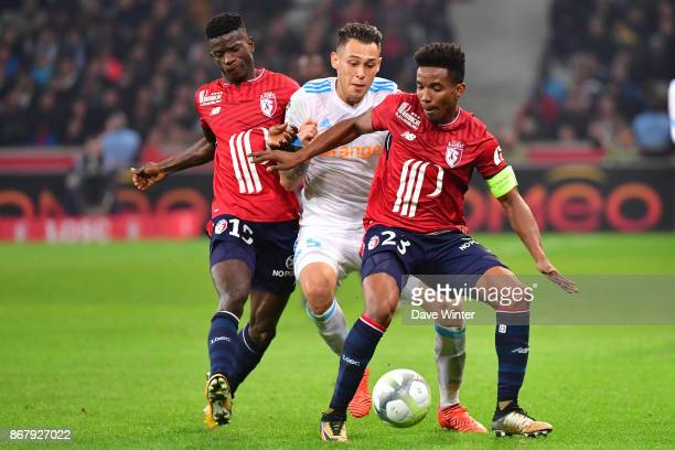 Edgar Ie of Lille Lucas Ocampos of Marseille and Thiago Mendes of Lille during the Ligue 1 match between Lille OSC and Olympique Marseille at Stade...