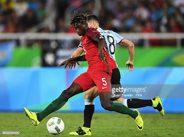Edgar IE of Portugal is challenged by Cristian Espinoza of Argentina during the Olympic Men's Football match between Portugal and Argentina at...