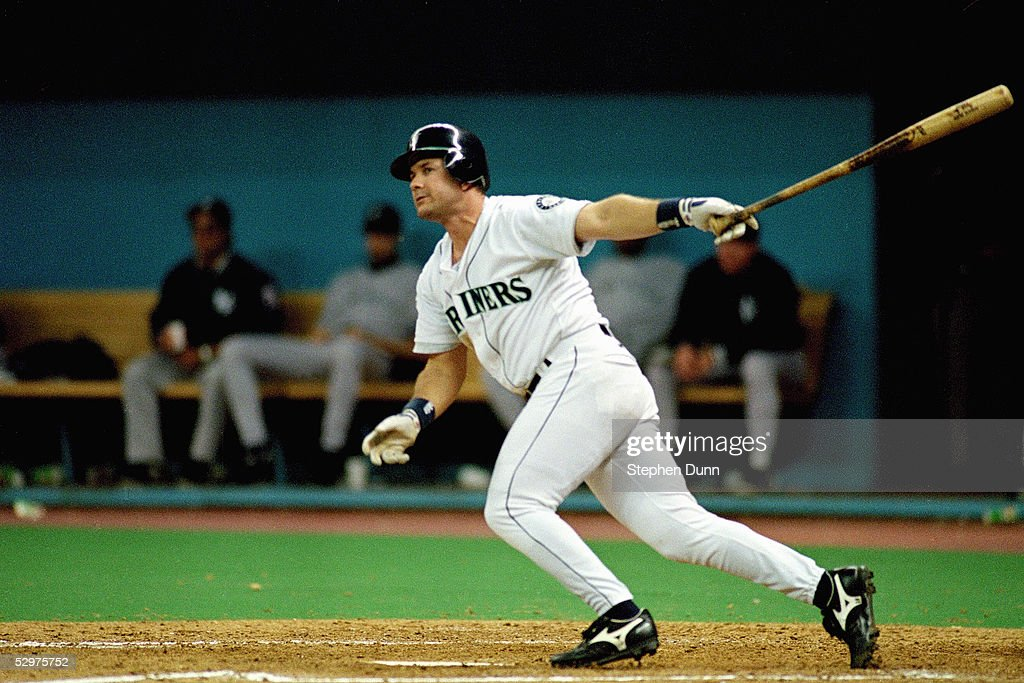 Edgar Martinez of the Seattle Mariners doubles home the game winning runs in Game five of the 1995 American League Divisional Series against the New...