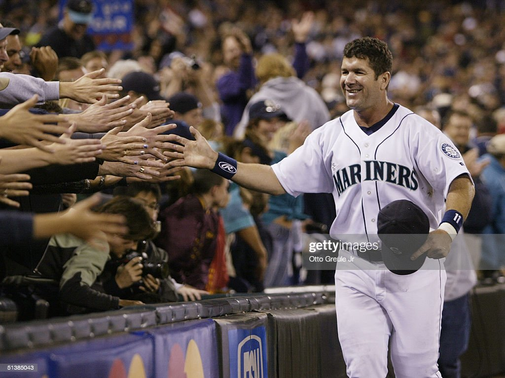 Edgar Martinez of the Seattle Mariners is greeted by fans as he takes a lap around the field during a post game ceremony honoring his career as a...
