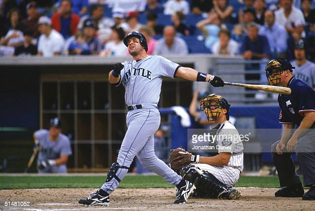 Edgar Martinez of the Seattle Mariners watches the flight of the ball as he follows through on his swing during a game against the Chicago White Sox...