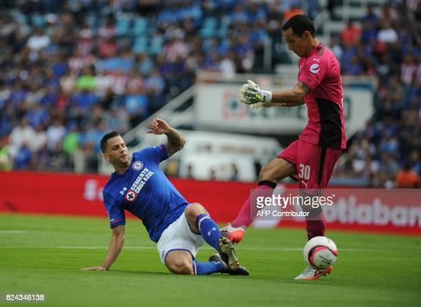 Edgar Mendez of Cruz Azul vies for the ball with Rodolfo Cota goal keeper of Guadalajara as part of the Torneo Apertura 2017 Liga MX at Azul Stadium...