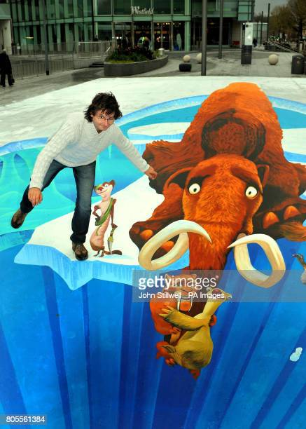 Edgar Mueller appears to be teetering on the brink of a fatal fall as he stands in the middle of his gigantic anamorphic pavement art outside the...