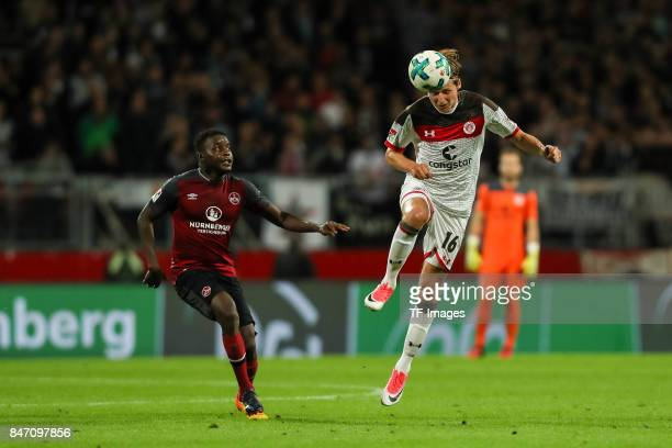 Edgar Nicaise Constant Salli of Nuernberg und Marc Hornschuh of St Pauli battle for the ball during the Second Bundesliga match between 1 FC...