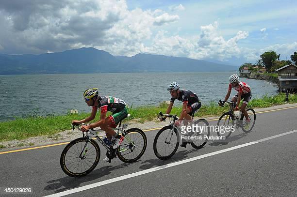 Edgar Nohales Nieto of Team 7 Eleven Roadbike Oscar Pujol Munoz of Skydive Dubai Pro Cycling Team and Hari Fitriyanto of Indonesia National Team ride...