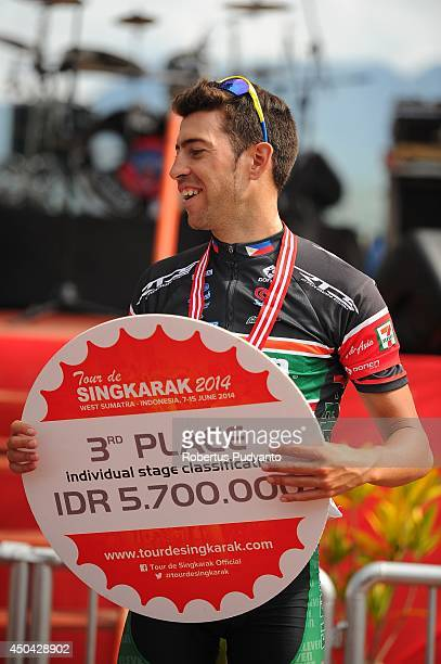 Edgar Nohales Nieto of Team 7 Eleven Roadbike Phillipine celebrates on the podium after taking the 3rd place on stage 5 of the 2014 Tour de Singkarak...