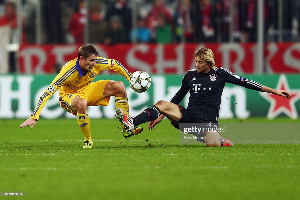 Edgar Olekhnovich (L) of Borisov is challenged by Anatoliy Tymoshchuk of Muenchen during the UEFA Champions League Group F match between FC Bayern Muenchen and FC BATE Borisov at Allianz Arena on December 5, 2012 in Munich, Germany.